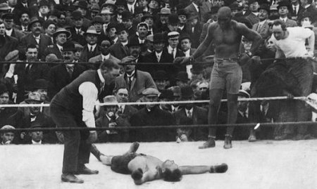 African American boxer Jack Johnson whooping some white dude.