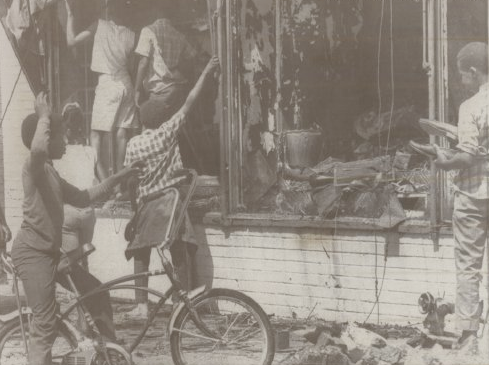 On June 27, 1969, these kids were pictured going through one of the burned out businesses along North 24th Street after the killing of Vivian Strong.