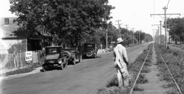 This pic shows a man walking along the Locust Street streetcar tracks near North 5th Street in 1924.