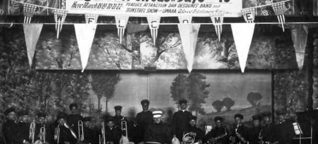 This is a 1922 image of the Dan Desdunes Band playing at a festival in Omaha.