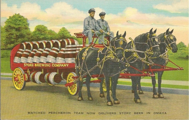 """A 1900s postcard shows percheron horses delivering Storz Brewing Company beer in Omaha, Nebraska. The caption says """"Matched percheron team now delivers Storz Beer in Omaha""""."""