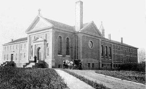The Poor Clares monastery in North Omaha in 1908, complete with additional rooms and the chapel. Its rose window is below the chimney.