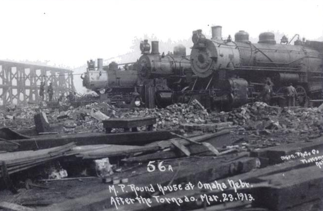 Before the 1913 Easter Sunday tornado, these locomotives were parked IN the Missouri Pacific Railroad roundhouse near North 16th and Locust Streets.