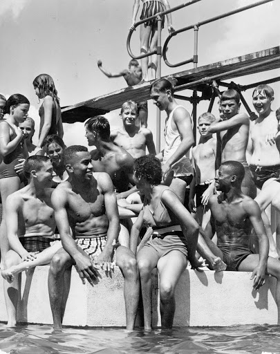 African American youth swim at Peony Park in 1955 after the NAACP Youth Council and others successfully boycotted the facility.