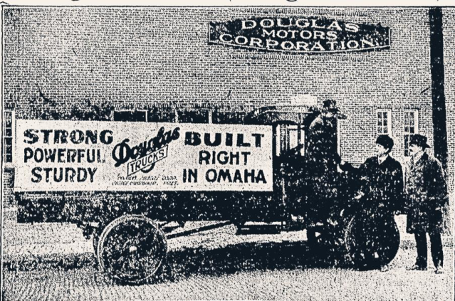 This 1920s image shows a Douglas Truck outside of the Douglas Motors Corporation factory on North 30th Street in North Omaha, Nebraska.