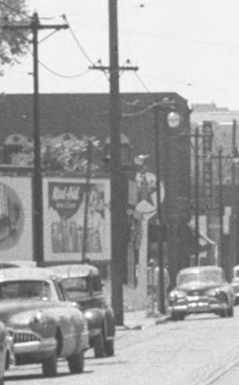 This 1940s pic shows a line of cars along North 24th Street in North Omaha, Nebraska, with the Texaco at 24th and Willis and Dreamland Ballroom in the distance.