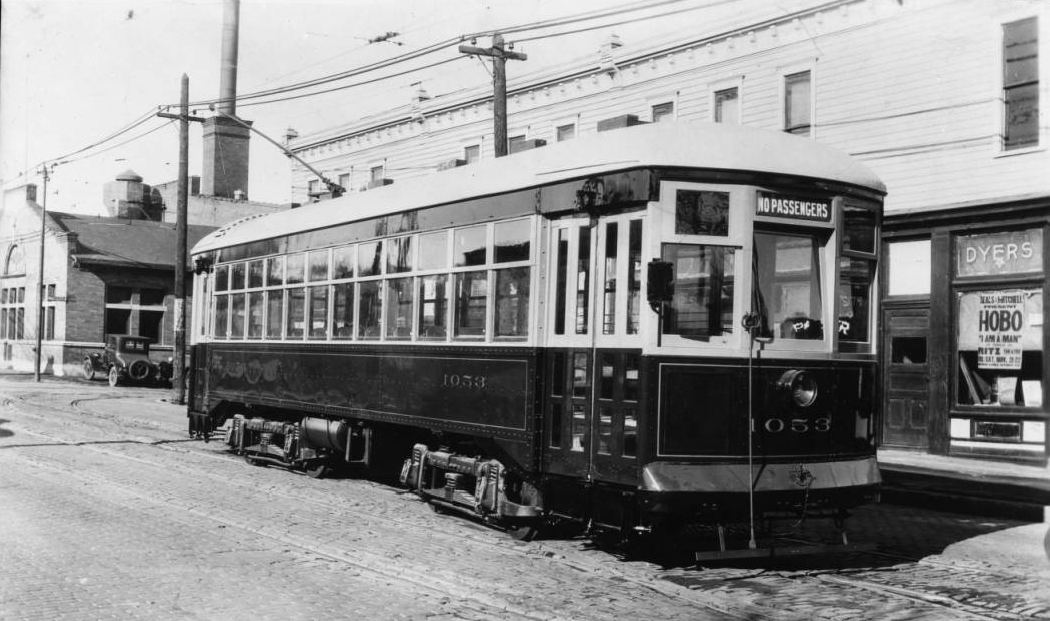 This image from 1928 shows a streetcar in front of the building on the northeast corner of N. 26th and Lake Streets. Notice the streetcar shop across the street. This two story building was home to several Black businesses, including barbers, clothiers and more.