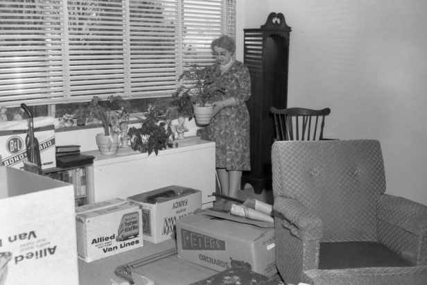This is a white woman moving her home in 1963.