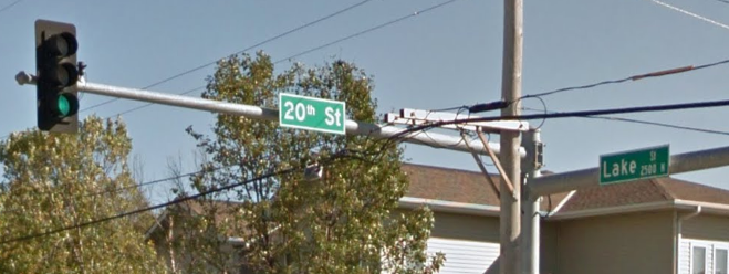Street signs at 20th and Lake in North Omaha, Nebraska.