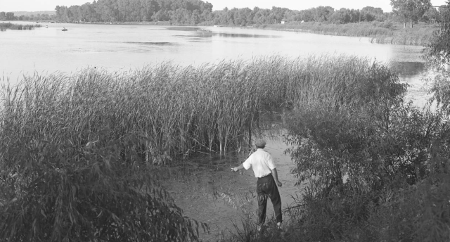 A fisherman in the reeds on Carter Lake in the 1910s. Photo courtesy of the Durham Museum.