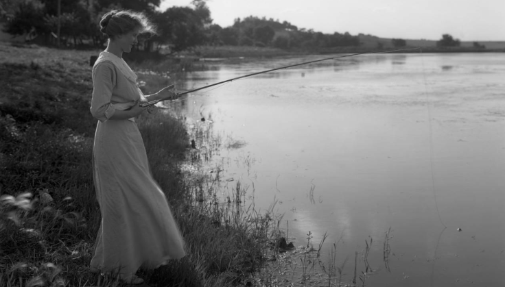 A woman fishing on Carter Lake in the 1910s. Photo courtesy of Durham Museum.