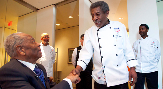 In this picture from the newspaper, Lee Wesley Gibson shakes hands with 66-year-old Willie James, a retired Union Pacific chef on Feb. 29, 2012. 101-yr.-old former Union Pacific porter, Lee Wesley Gibson, visits Union Pacific headquarters in downtown Omaha, Nebraska.
