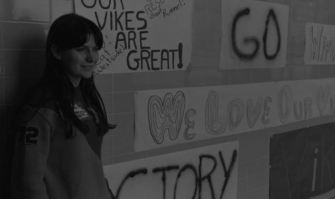A student stands beside cheer banners at North in 1971.
