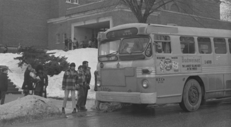Students getting on a bus at North in 1971.