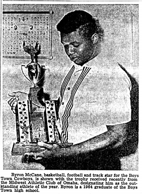 This is Byron McCane with a trophy from the Midwest Athletic Club in Omaha recognizing him as their Outstanding Athlete of the Year in 1964.