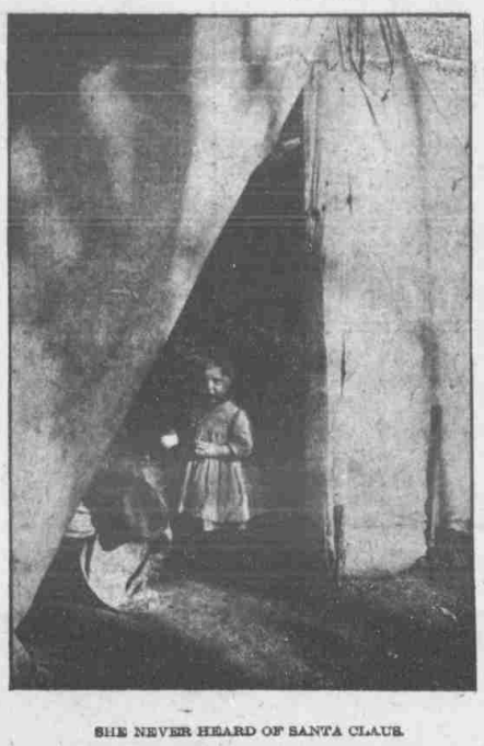 """This is a pic of a child in the North Omaha Bottoms in 1906. The caption says, """"She never heard of Santa Claus."""""""