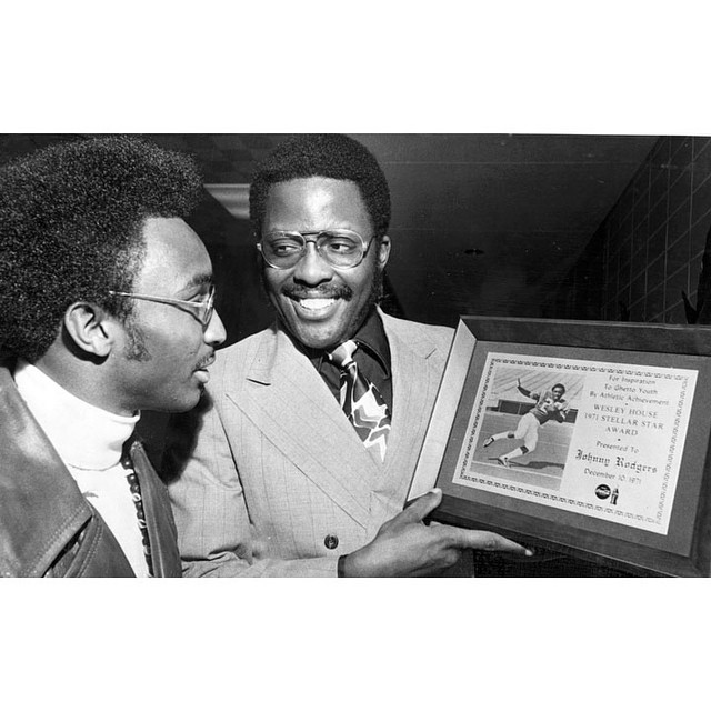This is a 1971 image of Rodney Wead (right) presenting an award to Johnny Rogers.