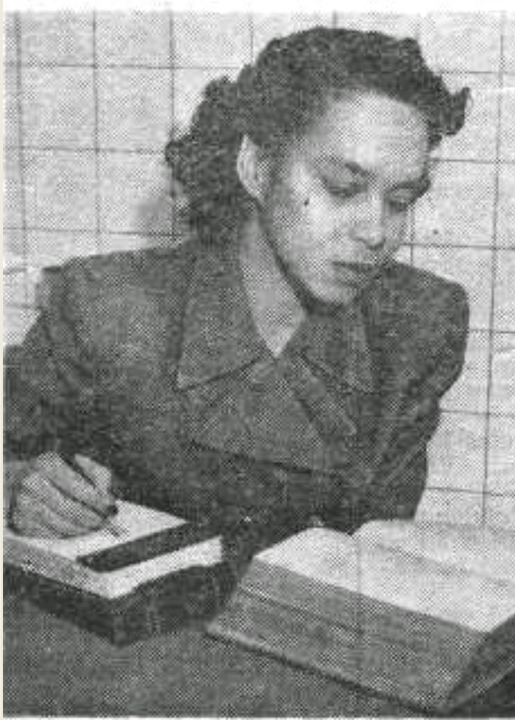 A young Elizabeth Davis takes notes in Omaha, Nebraska