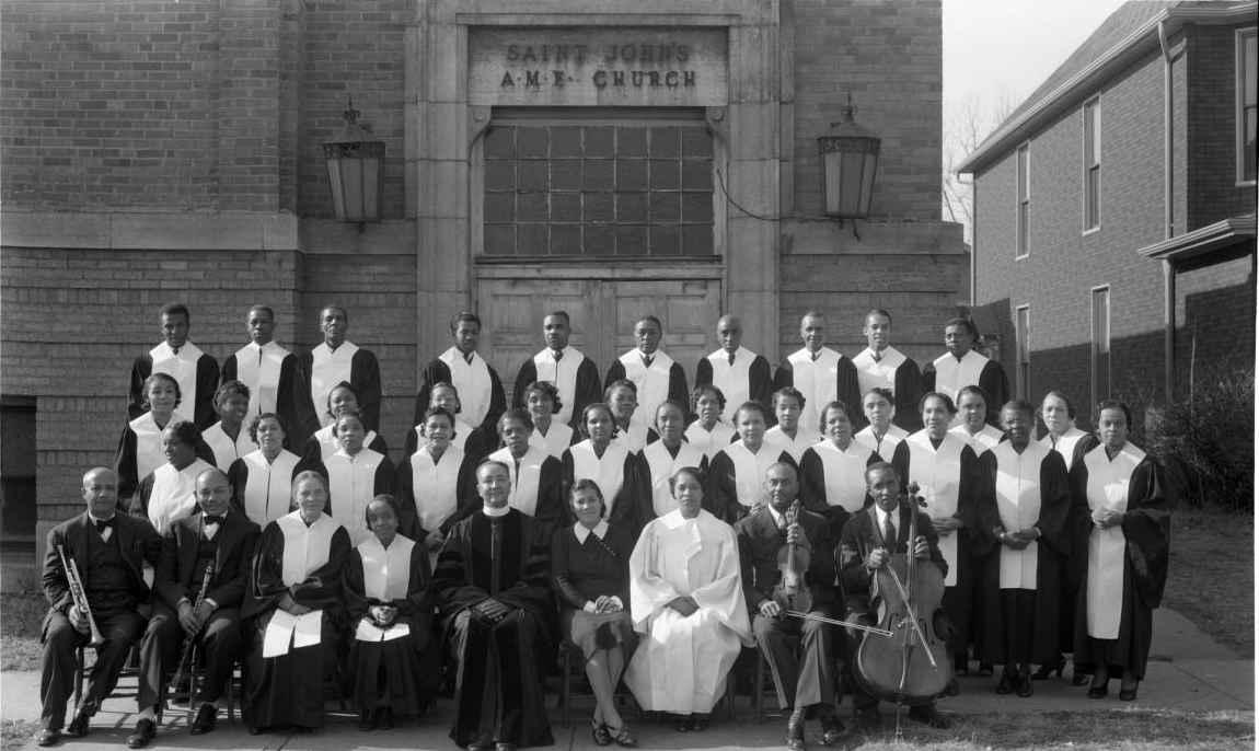 This 1939 pic shows a choir, instrumentalists and the Rev. outside of St. John's AME Church at N. 22nd and Willis.