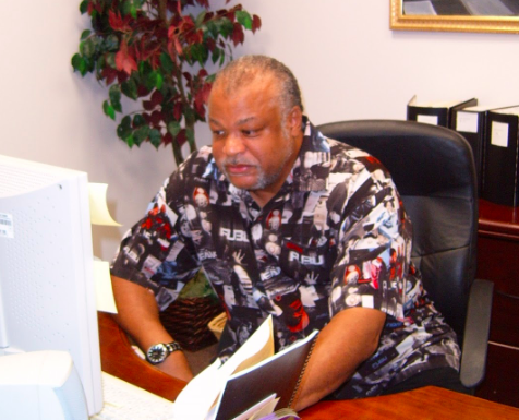 Matthew Stelly (1954-2019) sits at his desk in 2012.