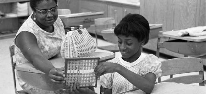 This is a 1968 pic of a mother and daughter at Saratoga School during a parent night program.