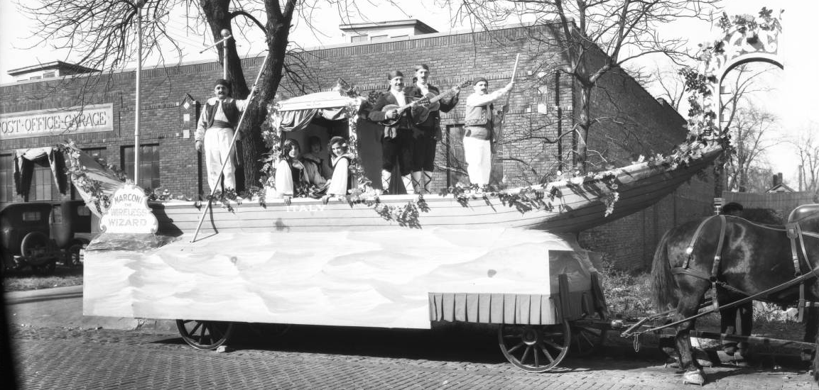 This float with men on a gondolier boat dressed in costume is from the city's Italian community circa 1930.